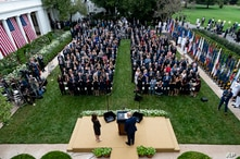 President Donald Trump, center, stands with Judge Amy Coney Barrett as they arrive for a news conference to announce Barrett as his nominee to the Supreme Court, in the Rose Garden at the White House in Washington, Sept. 26, 2020.
