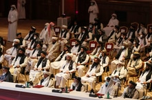 Members of the Taliban delegation attend the opening session of the peace talks between the Afghan government and the Taliban…