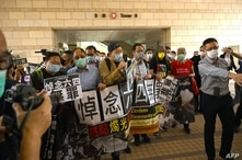 (FILES) In this file photo taken on November 03, 2020 pro-democracy activists demonstrate outside the West Kowloon court in…