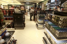 FILE - Chinese tourists shop in the Everrich duty free shopping mall in Kinmen county, Taiwan, Sept. 8, 2015.