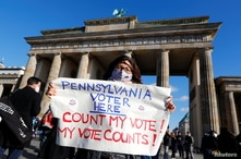 """Demonstrators gather during the """"Count the Votes! Rally for Fair Elections in the USA"""" rally organized by Young Democrats."""