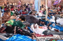 Ethiopian refugees who fled fighting in Tigray province lay in a hut at the Um Rakuba camp in Sudan's eastern Gedaref province, Nov. 16, 2020.