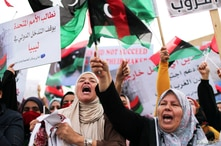 Libyan women chant slogans during a demonstration to demand an end to the Khalifa Haftar's offensive against Tripoli, in…