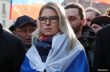 FILE - Russian opposition figure Lyubov Sobol takes part in a rally to mark the 5th anniversary of opposition politician Boris Nemtsov's murder and to protest against proposed amendments to the country's constitution, in Moscow, Feb. 29, 2020.