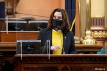 Michigan Gov. Gretchen Whitmer addresses the state's Electoral College at the state Capitol in Lansing, Michigan, U.S. December…