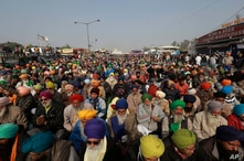 Protesting farmers listen to a speaker at the Delhi- Haryana border, outskirts of New Delhi, India, Dec. 17, 2020.