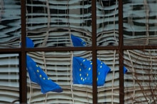 European Union flags are reflected in a window of the European Council in Brussels, Saturday, Dec. 19, 2020. The European Union…