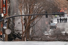 Emergency personnel work at the scene of an explosion in downtown Nashville, Tenn., Dec. 25, 2020.
