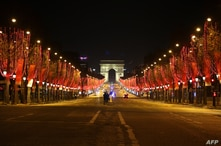 This picture shows the Champs Elysee avenue during the New Year's Eve as a 8:00 pm-6:00 am curfew is implemented in France to…