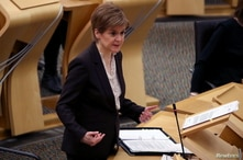Scottish First Minister Nicola Sturgeon delivers a statement at Holyrood, Edinburgh, announcing that Scotland will be placed in…