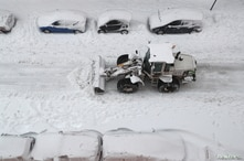 A bulldozer clears snow during a heavy snowfall in Madrid, Spain, Jan. 9, 2021.