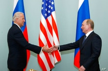 FILE - In this March 10, 2011, file photo, Vice President of the United States Joe Biden, left, shakes hands with Russian Prime…