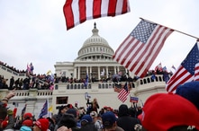 FILE - Supporters of President Donald Trump gather outside the U.S. Capitol in Washington, D.C., Jan. 6, 2021.