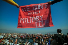 Protesters wearing traditional Shan dress take part in a demonstration against the Myanmar military coup in Inle lake, Shan…