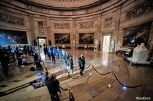 House impeachment managers walk the article of impeachment against former U.S. President Donald Trump through the Rotunda of the U.S. Capitol in Washington, U.S., January 25, 2021.
