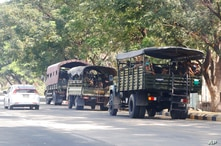 Soldiers sit inside trucks parked on a road in Naypyitaw, Myanmar, Monday, Feb. 1, 2021. Myanmar military television said…