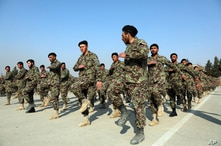 FILE - In this Jan. 18, 2021, file photo newly graduated Afghan National Army march during their graduation ceremony after a…