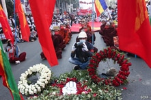 "Buddhist monks and demonstrators stage a ""sit-down"" strike in Mandalay, Feb. 22, 2021, to protest against the Feb. 1 military coup which toppled Myanmar's civilian leader Aung San Suu Kyi's government."