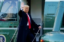 FILE - Then-President Donald Trump boards Marine One on the South Lawn of the White House, as he departs Washington, Jan. 20, 2021. Trump has named two lawyers to his impeachment defense team, after parting ways with an earlier set of attorneys.