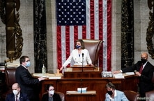 U.S. Speaker of the House Nancy Pelosi (D-CA) wields her gavel ahead of the final passage in the House of Representatives of U…