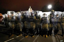 FILE - In this Jan. 6, 2021, file photo, members from the District of Columbia National Guard stand outside the Capitol after a…