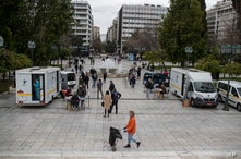 Medical staff of the National Health Organisation (EODY) conduct rapid tests for the COVID-19 as people queue in Syntagma square, central Athens, March 7, 2021.