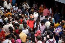 People crowd along a busy road in Mumbai on April 12, 2021, as India overtook Brazil as the country with the second-highest…