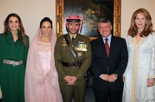 A handout picture released by the Jordanian news agency Petra, shows Jordan's King Abdullah (2nd R), Queen Noor, widow of late…