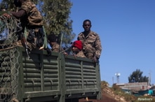 Ethiopian soldiers ride on a truck near the town of Adigrat, Tigray region, Ethiopia, March 18, 2021. REUTERS/Baz Ratner    …