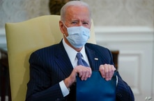 FILE - President Joe Biden is seen in the Oval Office of the White House in Washington, Feb. 3, 2021.