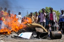 Anti-government protesters burn photographs of President Mohamed Abdullahi Mohamed, also known as Farmajo, in the Fagah area of Mogadishu, Somalia, April 25, 2021.