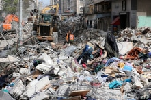 An excavator clears the rubble of a destroyed building in Gaza City's Rimal residential district on May 16, 2021, following…