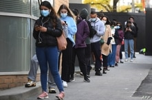 People queue for a Covid-19 test in Melbourne on May 27, 2021 after five million people in Melbourne were ordered into a snap…