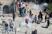 Palestinian protesters participate during a demonstration to show their solidarity amid Israel-Gaza fighting, at Jerusalem's Old City, May 18, 2021.