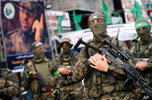Hamas militants parade through the streets for Bassem Issa, a top Hamas' commander, who was killed by Israeli Defense Force…