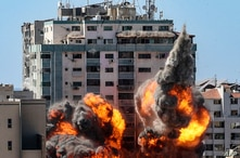 Fire balls erupt at the Jala Tower as it is hit by an Israeli airstrike in Gaza City, May 15, 2021. The building housed a number of foreign media offices, including those of the Associated Press.