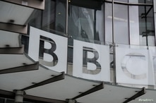 FILE - Signage is seen at BBC offices and recording studios, in London, Britain, May 21, 2021.