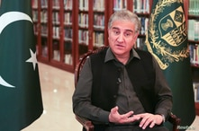 FILE - Pakistan's Foreign Minister Shah Mehmood Qureshi gestures as he speaks during an interview at the Foreign Ministry in Islamabad, Pakistan, March 1, 2020.