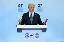 US President Joe Biden takes part in a press conference on the final day of the G7 summit at Cornwall Airport Newquay, near…
