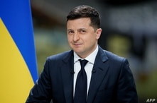 Ukraine's President Volodymyr Zelenskiy looks on during his annual news conference at the Antonov aircraft plant in Kyiv,…