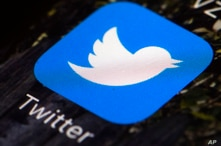 FILE - In this April 26, 2017, file photo is a Twitter app icon on a mobile phone in Philadelphia. Millions of Nigerians were…