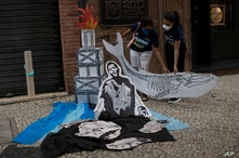 Activists hold a cutout depicting a whale skeleton on World Ocean Day, in Rio de Janeiro, Brazil June 8, 2021.