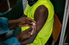A Zimbabwean receives a COVID-19 vaccine jab at Wilkins Hospital - Zimbabwe's main vaccination center in Harare