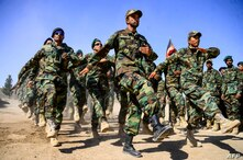 FILE - Afghan National Army soldiers march during a ceremony at a military base in the Guzara district of Herat province, Oct. 11, 2020.