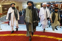 FILE - Deputy chief for Taliban political affairs, Mullah Abdul Ghani Baradar, center, arrives with other members of the Taliban delegation for a peace conference in Moscow, Russia, March 18, 2021.