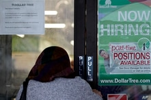 A shopper enters a retail store as a hiring sign shows in Buffalo Grove, Ill., Thursday, June 24, 2021.  America's employers…