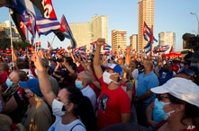 People attend a cultural-political event on the seaside Malecon Avenue with thousands of people in a show of support for the…