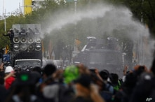 Police use water cannons to disperse anti-government protesters in Bangkok, Thailand, July 18, 2021. Hundreds of demonstrators rallied on Sunday despite the government's recent coronavirus measures to prohibit the gathering of more than five people.