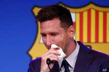 Lionel Messi cries at the start of a press conference at the Camp Nou stadium in Barcelona, Spain, Aug. 8, 2021.