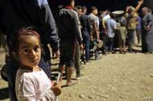 TOPSHOT - Syrians who have been recently turned refugees by the Turkish military operation in northeastern Syria are pictured…